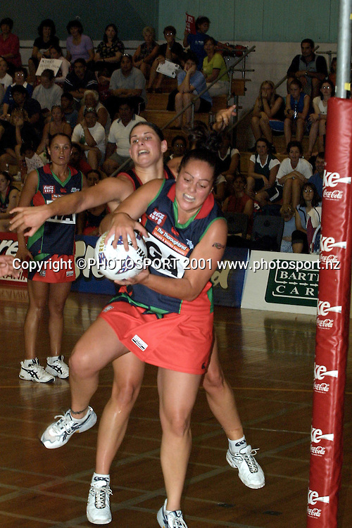 Jodi Whitmore in action during the Coca-Cola netball match between the Flames and the Cometz, 25 March, 2001 Photo: PHOTOSPORT *** Local Caption ***