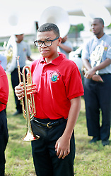 29 August 2014. Lower 9th Ward, New Orleans, Louisiana.<br /> Hurricane Katrina memorial 9 years later. <br /> Jalil Gioustovia (11 yrs) from the Martin Luther King Jr Charter High School band at the official memorial in remembrance of the day Hurricane Katrina swamped the community.<br /> Photo; Charlie Varley/varleypix.com