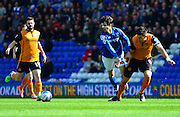 Diego Fabbrini is fouled by Wolves captain Danny Batth during the Sky Bet Championship match between Birmingham City and Wolverhampton Wanderers at St Andrews, Birmingham, England on 11 April 2015. Photo by Alan Franklin.