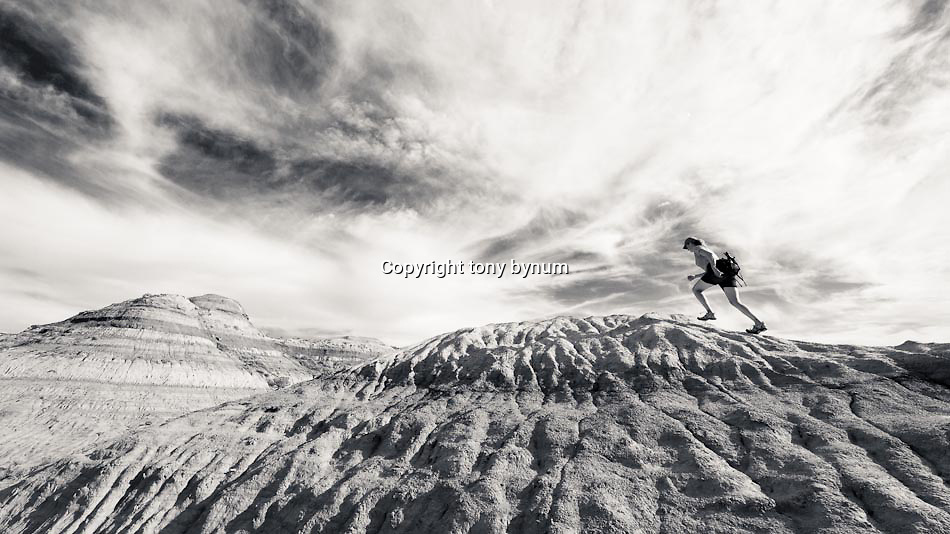 hiker in badlands of eastern montana conservation photography - montana wild prairie