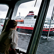 Three weeks aboard the Kong Harald. Hurtigruten, the Coastal Express. The bridge of the Kong Harald. A waitress is looking at the Polarys through the windows of the bridge.
