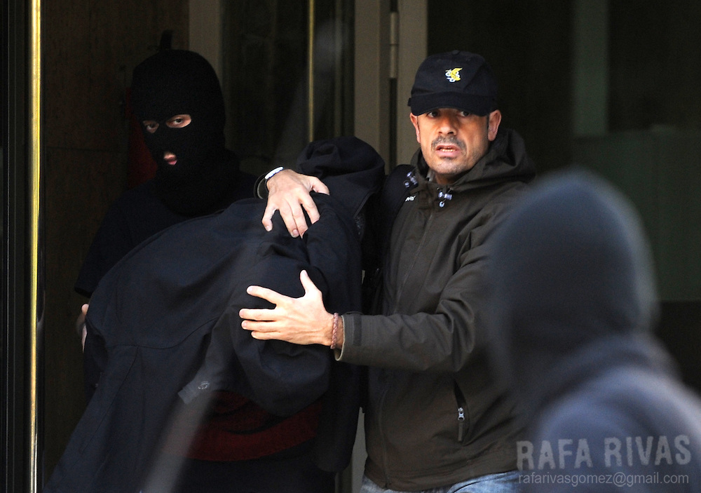 An unidentified suspect of being a member of pro-independence young Basque association SEGI  is taken away from the National Police headqurters after his arrest, on November 24, 2009, in the northern Spanish Basque city of San Sebastian. 36 people were arrested by Spanish National Police during an anti-terrorist operation, in the Basque Country and Navarra, ordered by Spanish judge Grande Marlaska.  PHOTO/Rafa Rivas