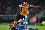 Brighton central defender, Lewis Dunk (5) fouls Hull City defender Harry Maguire (12) and concedes a penalty kick during the The FA Cup match between Hull City and Brighton and Hove Albion at the KC Stadium, Kingston upon Hull, England on 9 January 2016.