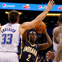 March 11, 2012; Orlando, FL, USA; Indiana Pacers point guard Darren Collison (2) looks to pass the ball past Orlando Magic power forward Ryan Anderson (33) during the third quarter of a game at  Amway Center. The Magic defeated the Pacers 107-94.  Mandatory Credit: Derick E. Hingle-US PRESSWIRE