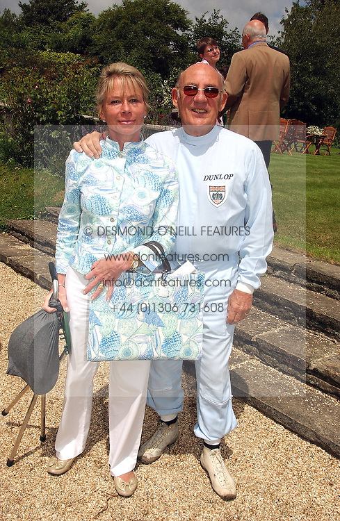 """SIR STIRLING & LADY MOSS he is the racing driver at a luncheon hosted by Cartier at the 2004 Goodwood Festival of Speed on 27th June 2004.  Cartier sponsored the """"Style Et Luxe' for vintage cars on the final day of this annual event at Goodwood House, West Sussex."""