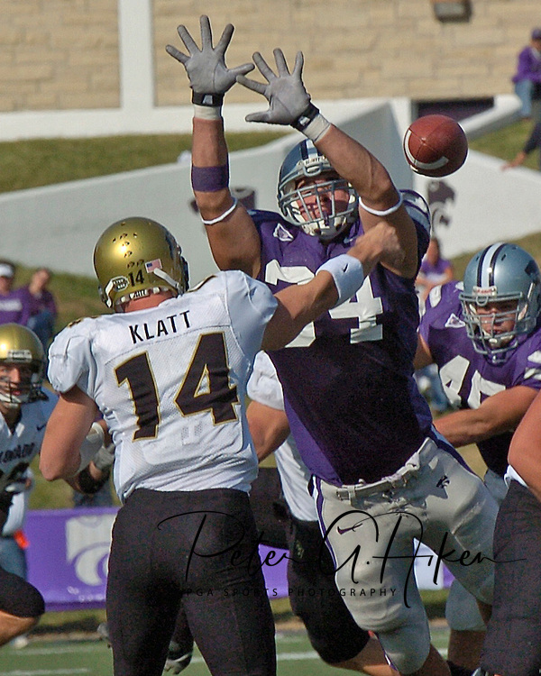 Colorado quarterback Joel Klatt (14) gets the pass off as Kansas State defensive end Blake Seiler (34) goes for the block in the first half at KSU Stadium in Manhattan, Kansas, October 29, 2005.  The Buffaloes beat K-State 23-20.