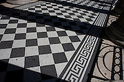 Wide detail of Romanesque mosaic tiled flooring on the outside terrace of London's National Portrait Gallery, Trafalgar Sq.