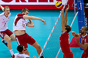 (L) Marcin Mozdzonek from Poland spikes during the 2013 CEV VELUX Volleyball European Championship match between Poland and Turkey at Ergo Arena in Gdansk on September 20, 2013.<br /> <br /> Poland, Gdansk, September 20, 2013<br /> <br /> Picture also available in RAW (NEF) or TIFF format on special request.<br /> <br /> For editorial use only. Any commercial or promotional use requires permission.<br /> <br /> Mandatory credit:<br /> Photo by &copy; Adam Nurkiewicz / Mediasport