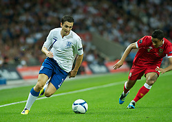LONDON, ENGLAND - Tuesday, September 6, 2011: England's Stewart Downing in action against Wales during the UEFA Euro 2012 Qualifying Group G match at Wembley Stadium. (Pic by Gareth Davies/Propaganda)