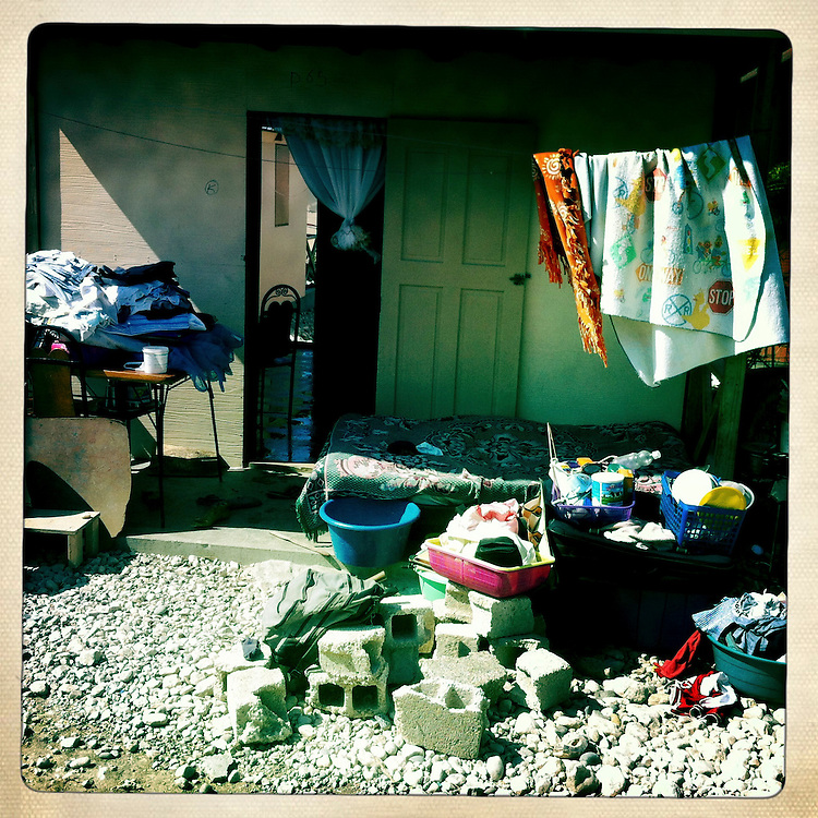 A family's belongings are all put outside as they clean their house at the Corail camp on Friday, April 6, 2012 in Port-au-Prince, Haiti.