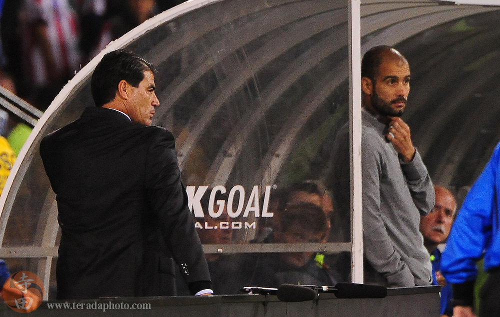 August 8, 2009; San Francisco, CA, USA; Chivas de Guadalajara head coach Francisco Ramirez (left) is ejected out of the game as FC Barcelona head coach Josep Guardiola (right) looks on during the second half in the Night of Champions international friendly contest at Candlestick Park. The game ended in a 1-1 tie.