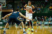 WACO, TX - JANUARY 28: Isaiah Austin #21 of the Baylor Bears brings the ball up court against the West Virginia Mountaineers on January 28, 2014 at the Ferrell Center in Waco, Texas.  (Photo by Cooper Neill/Getty Images) *** Local Caption *** Isaiah Austin