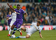 Bolton Wanderers forward Sammy Ameobi is tackled by Leeds United defender Gaetano Berardi  during the EFL Sky Bet Championship match between Leeds United and Bolton Wanderers at Elland Road, Leeds, England on 30 March 2018. Picture by Paul Thompson.