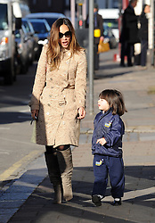 Myleene Klass wearing large sunglasses, a £1,395.00 Burberry beige lace trench coat and a pair of grey knee high boots  on the school run with her youngest daughter Hero in north London, UK. 27/02/2015<br />