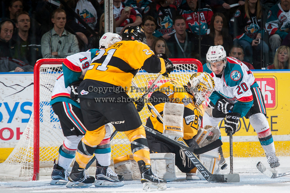 KELOWNA, CANADA - MAY 13: Gage Quinney #20 of Kelowna Rockets tries to put the puck past Jordan Papirny #33 of Brandon Wheat Kings on May 13, 2015 during game 4 of the WHL final series at Prospera Place in Kelowna, British Columbia, Canada.  (Photo by Marissa Baecker/Shoot the Breeze)  *** Local Caption *** Jordan Papirny; Gage Quinney;