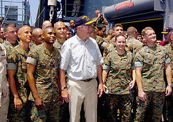 Former President George H. W. Bush is flanked by Marines while posing for a photo aboard the amphibious dock landing ship USS Fort McHenry (LSD 43). Sailors and Marines greeted former President Bill Clinton and George H. W. Bush as they toured Sri Lanka, Thailand and Indonesia to see first hand, the effects the tsunami had on Southeast Asia on February 20, 2005. Photo Michael D. Kennedy/USN via ABACA.