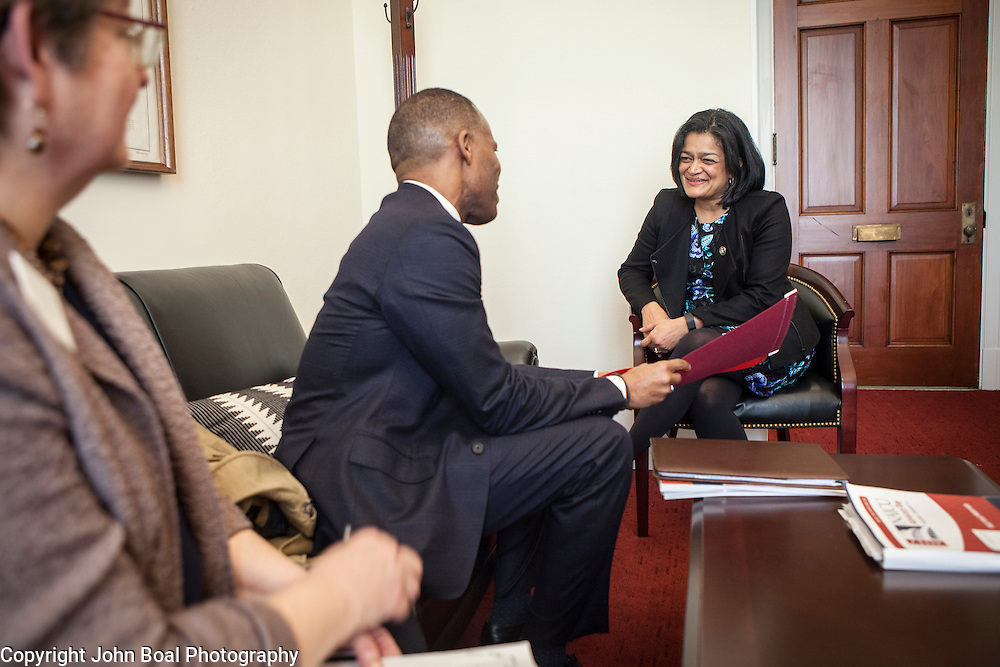 Representative Pramila Jayapal (D-WA, 7) listens to Isiaah Crawford and Violet Boyer, left, of the National Association of Independent Colleges and Universities, on Tuesday, January 31, 2017.  This was the last of 4 30-minute meetings with constituent advocacy groups during the day.  John Boal photo/for The Stranger