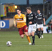 Dundee's Jim McAlister races past Motherwell's Stuart Carswell -  Dundee v Motherwell, SPFL Premiership at Dens Park <br /> <br /> <br />  - &copy; David Young - www.davidyoungphoto.co.uk - email: davidyoungphoto@gmail.com