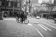 2017 MARCH 05 - Cyclist at the corner of 4th Ave and Union St, downtown, Seattle, WA, USA. By Richard Walker