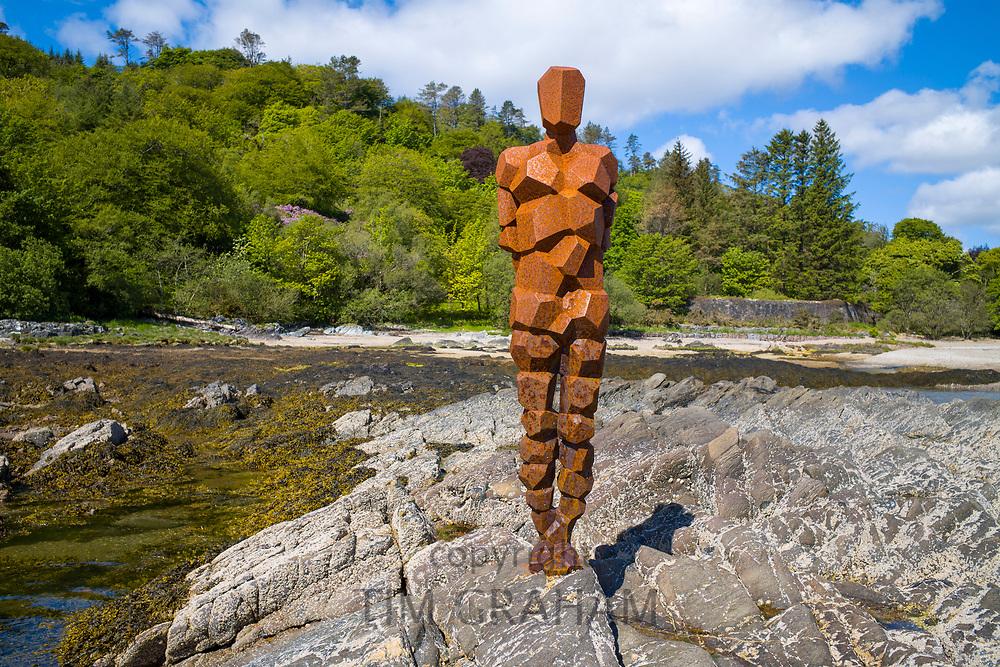 Antony Gormley sculpture GRIP of an abstract human form looking out over Saddell Bay, Kilbrannan Sound to Arran, in Kintyre, Scotland