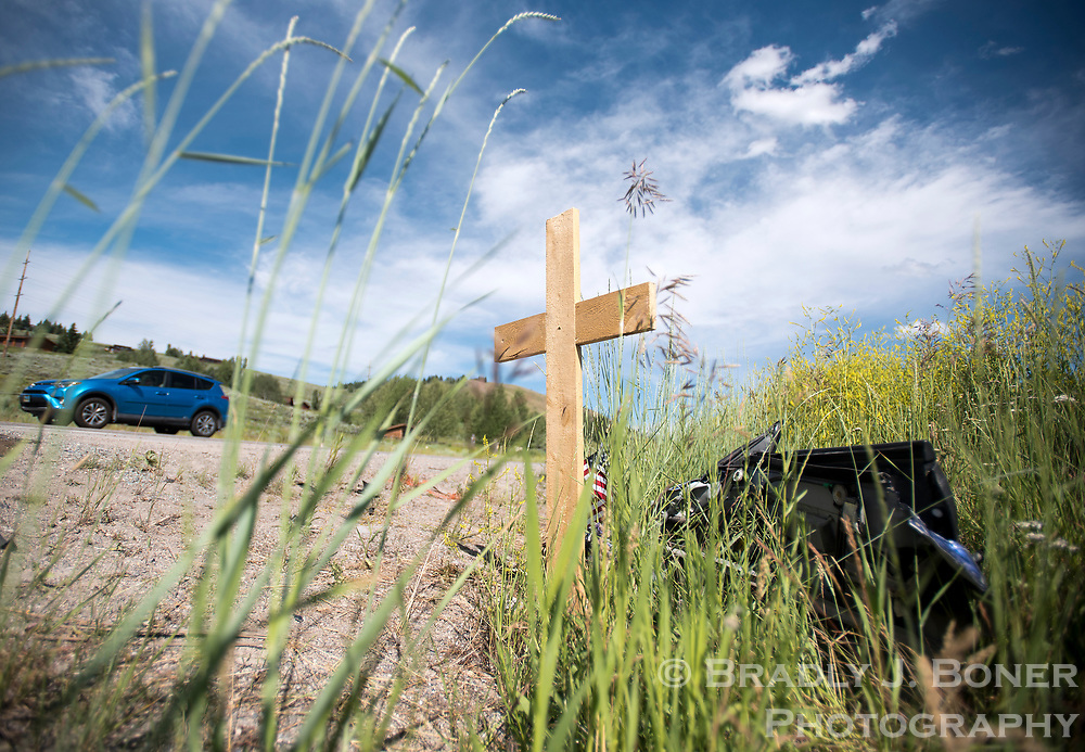 An impromptu memorial is seen at the site of an accident on Highway 22 that killed long-time Jackson resident Bob Arndt last week.