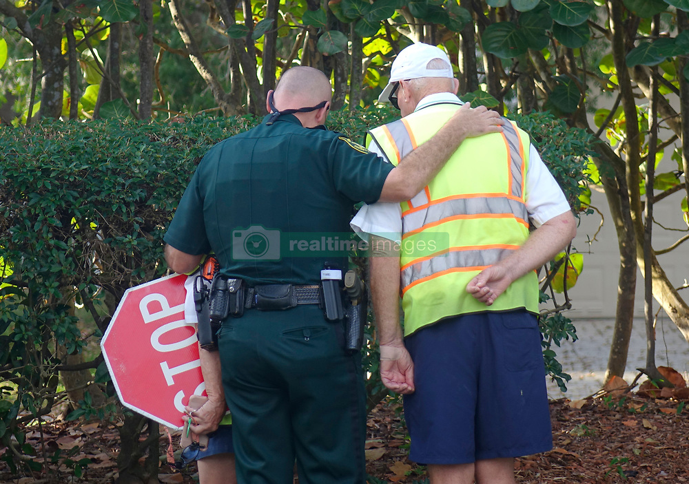Broward Sheriff Deputy Chris Rossi comforts school crossing guards at Marjory Stoneman High School in Parkland, Thursday, February 15, 2018. The volunteer crossing guards, who did not want to give thier names, had not heard that school had been cancelled because of Wednesday's shooting. Photo by Amy Beth Bennett/Sun Sentinel/TNS/ABACAPRESS.COM