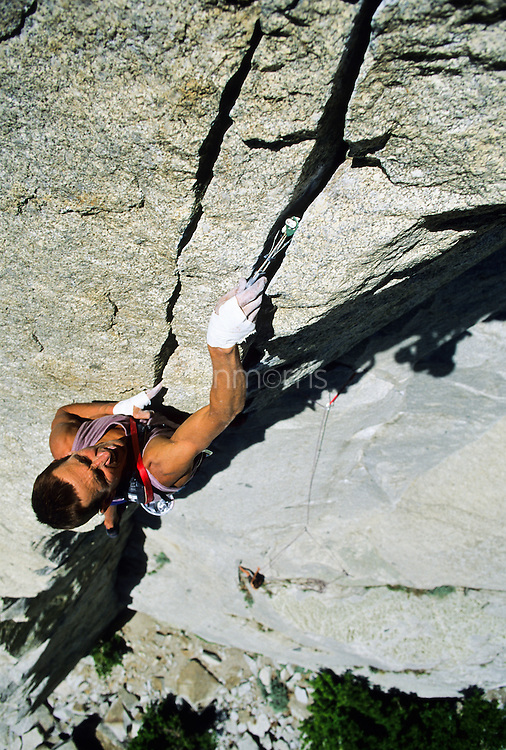 Dale Bard places a cam on the classic climb, Gordon's Hangover, 5.9+, Little Cottonwood Canyon, Utah