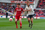 Middlesbrough FC striker David Nugent holds the ball from Fulham defender Dan Burn during the Sky Bet Championship match between Middlesbrough and Fulham at the Riverside Stadium, Middlesbrough, England on 17 October 2015. Photo by George Ledger.