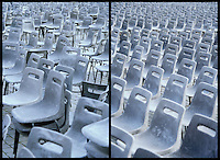 Stacked chairs and chairs in rows in Vatican Square St Peters Square Berninis Square Piazza St Pietro Vatican City Rome Italy