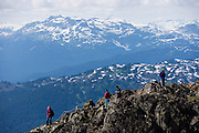 Hikers view the Coast Range from atop Whistler Peak, British Columbia, Canada. The Resort Municipality of Whistler is popular for year-round  outdoor sports aided by gondolas and chair lifts.