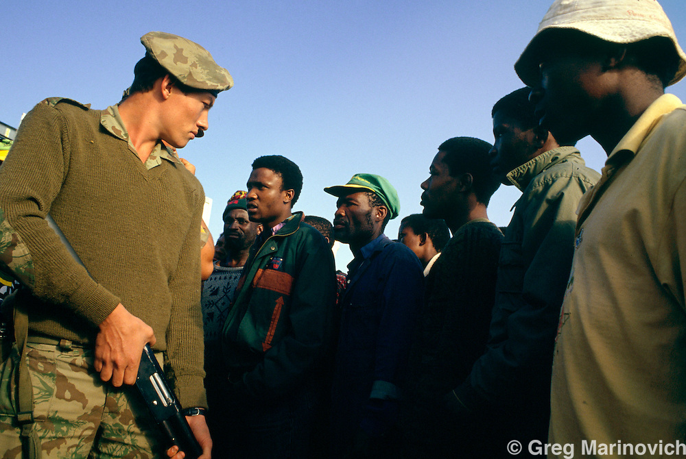 Boipatong, Vaal Triangle, Transvaal, South Africa June 1992. Residents confront a riot policemen as they try to discover the identity of a man killed by police in this tonship in the wake of the massacre of some 41 men women and children by Inkatha Freedom Party members allegedly supported by security forces.