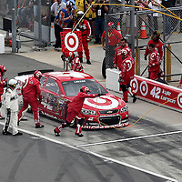 Kyle Larson pits after hitting the wall during the 56th Annual NASCAR Daytona 500 practice session at Daytona International Speedway on Saturday, February 22, 2014 in Daytona Beach, Florida.  (AP Photo/Alex Menendez)