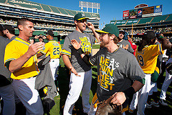 OAKLAND, CA - SEPTEMBER 22: (L-R) Grant Balfour #50 of the Oakland Athletics, Nate Freiman #7 and Eric Sogard #28 celebrate after the game against the Minnesota Twins at O.co Coliseum on September 22, 2013 in Oakland, California. The Oakland Athletics defeated the Minnesota Twins 11-7 as they clinched the American League West Division. (Photo by Jason O. Watson/Getty Images) *** Local Caption *** Grant Balfour; Nate Freiman; Eric Sogard