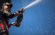 German Grand Prix<br /> <br /> Sebastian Vettel sprays champagne to celebrate winning the 2013 German grand prix at the Nurburgring. <br /> ©Darren Heath/exclusivepix
