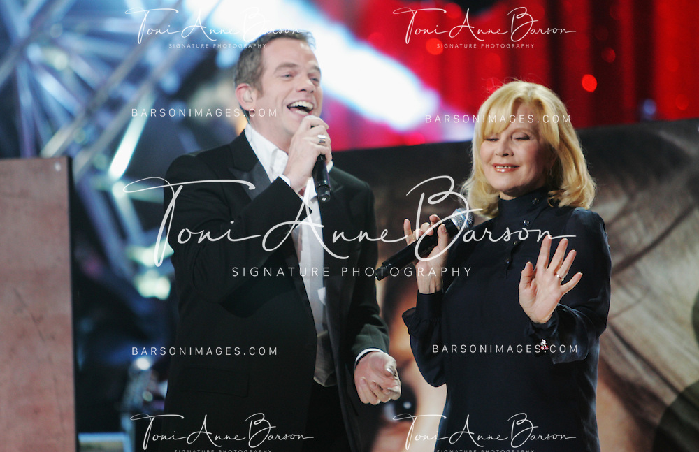 PARIS - JANUARY 20:  Garou and Sylvie Vartan perform at L'Olympia on January 20, 2010 in Paris, France.  (Photo by Tony Barson/WireImage)