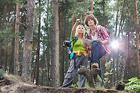 Young hiking couple with map discussing over direction in forest