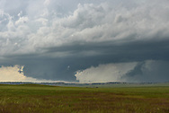 A wall cloud hangs underneath a storm base near Lingle, Wyoming. This storm would produce a tornado 5 minutes later, but it wasn't visible from my position.