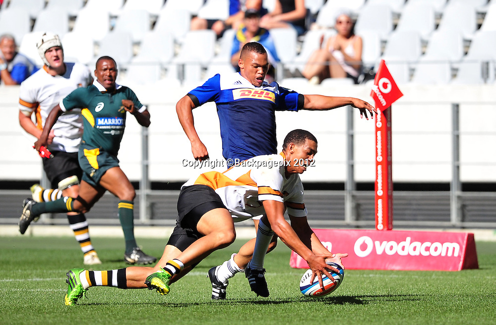 Wilneth Engelbrecht of Boland dives on the ball ahead of Godlen Masimla of the Stormers during the pre-season friendly between the Boland Cavaliers and the Stormers at Cape Town Stadium on 7 February 2015 ©Ryan Wilkisky/BackpagePix