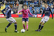 Millwall defender Mahlon Romeo (12) and Millwall midfielder Jed Wallace (7) battle for possession with Queens Park Rangers midfielder Luke Freeman (7) during the EFL Sky Bet Championship match between Millwall and Queens Park Rangers at The Den, London, England on 10 April 2019.