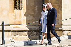 Windsor, UK. 21st April 2019. The Duke and Duchess of Cambridge arrive to attend the Easter Sunday service at St George's Chapel in Windsor Castle.