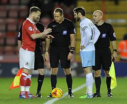 Bristol City's Wade Elliott flips a coin for kick off - Photo mandatory by-line: Dougie Allward/JMP - Mobile: 07966 386802 - 10/12/2014 - SPORT - Football - Bristol - Ashton Gate Stadium - Bristol City v Coventry City - Johnstone's Paint Trophy