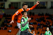 AFC Wimbledon defender Ryan Delaney (21), on loan from Rochdale, battles in the air during the EFL Sky Bet League 1 match between Blackpool and AFC Wimbledon at Bloomfield Road, Blackpool, England on 16 November 2019.
