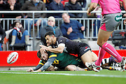 Australia's Josh Dugan gets the touch to score his second try of the day during the Ladbrokes Four Nations match between Australia and New Zealand at Anfield, Liverpool, England on 20 November 2016. Photo by Craig Galloway.