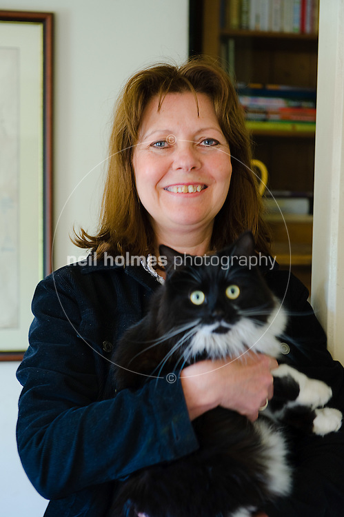 Mosquito Cottage on Main Street, Gillian  Vincent with her cat, Bishop Wilton village East Yorkshire