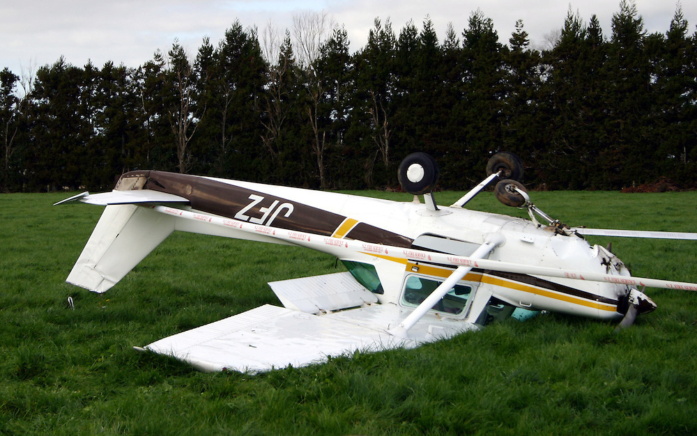 A Cessna 152 flipped after making a forced landing in a paddock near Clevedon injuring the two occupants, Auckland, New Zealand, Sunday, June 29, 2014. Credit:SNPA / Grahame Clark