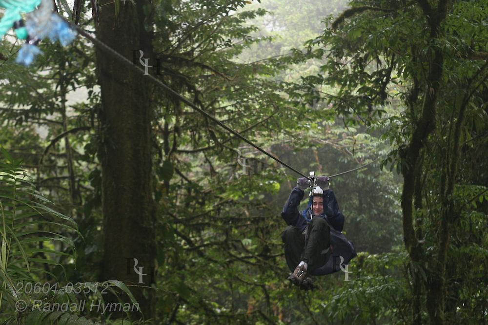 Ecoteach kid Luke Seibel (16) ziplines through the Monteverde cloud forest on Sky Trek cable; Monteverde, Costa Rica.