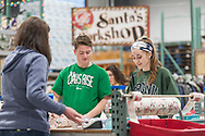 """20181204, Tuesday, December 4, 2018, Darmouth, MA, USA – The My Brother's Keeper Christmas program is expanding in it's 28th season to begin wrapping and delivering from it's brand new Dartmouth location on the South Coast and held it's very first volunteer session Tuesday December 4, 2018. Combined with the My Brother's Keeper facility in Easton the organization is planning to serve over 3,000 families with over 12,000 parents and children for 2018.<br />  <br /> The charity gift giving and wrapping program, in it's 28th year at the Easton facility, is ongoing in """"Santa's Workshop"""" during the Advent season 11 a.m. to 8 p.m. each day. The new Dartmouth facility will be operating on Tuesday, Thursday and Saturday from 11-4 up until December 22.<br /> <br /> ( 2018 © lightchaser photography )"""
