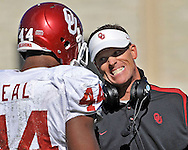 Defensive Coordinator Brent Venables, right, of the Oklahoma Sooners has a talk with defensive end Jeremy Beal #44 during the first half against the Kansas State Wildcats at Bill Snyder Family Stadium in Manhattan, Kansas.  The Oklahoma Sooners won 58-35.