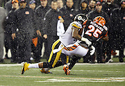Cincinnati Bengals running back Giovani Bernard (25) gets hit hard by Pittsburgh Steelers inside linebacker Ryan Shazier (50) causing a third quarter fumble, recovered by Shazier, and starting a player melee over no penalty call for unnecessary roughness and leading with the helmet during the NFL AFC Wild Card playoff football game against the Pittsburgh Steelers on Saturday, Jan. 9, 2016 in Cincinnati. The Steelers won the game 18-16. (©Paul Anthony Spinelli)