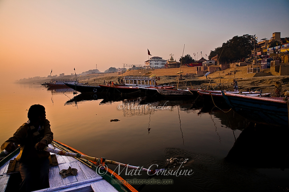 The early morning light illuminates the calm waters of the Ganges.<br /> (Photo by Matt Considine - Images of Asia Collection)